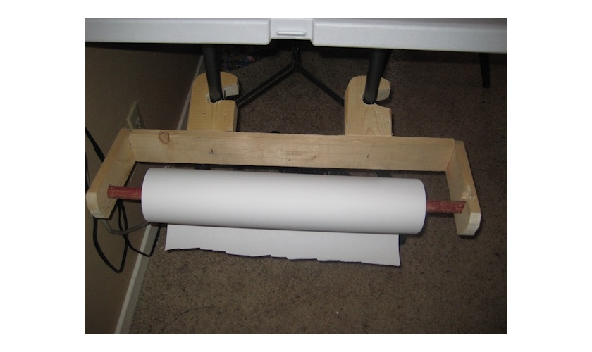 Wood paper roll dispensor for Nancy's craft room.